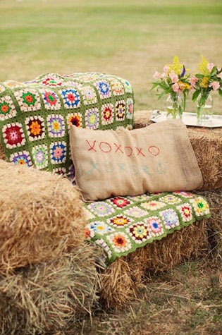 Country party theme as hay bale love seat.